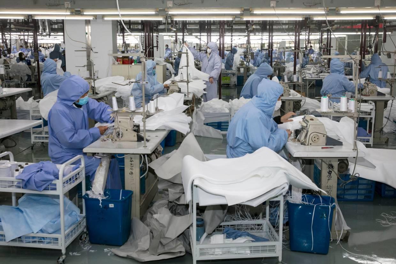 Người dân Trung Quốc đang trở lại làm việc sau Tết như thế nào trong mùa dịch corona? - Ảnh 2.