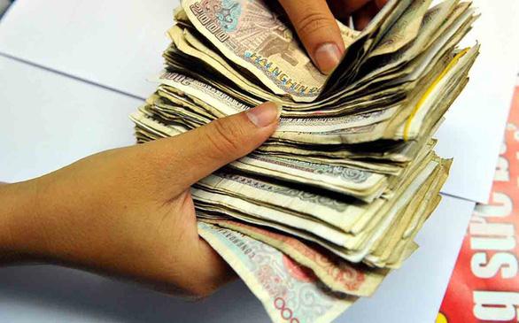 Ngân hàng Nhà nước và loạt nhà băng giảm, miễn phí chuyển khoản, thanh toán không tiền mặt phòng corona - Ảnh 2.