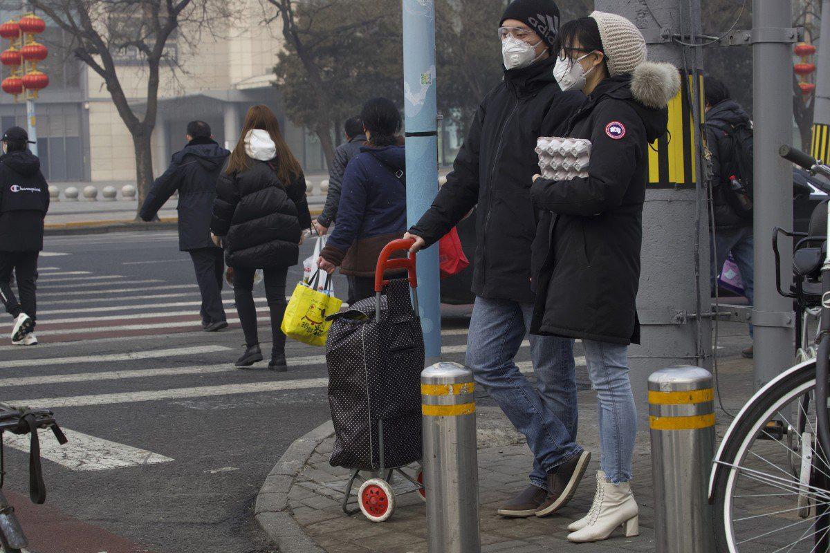Chưa đến 1/3 lao động dám đi làm, kinh tế Trung Quốc dường như không còn hoạt động - Ảnh 1.