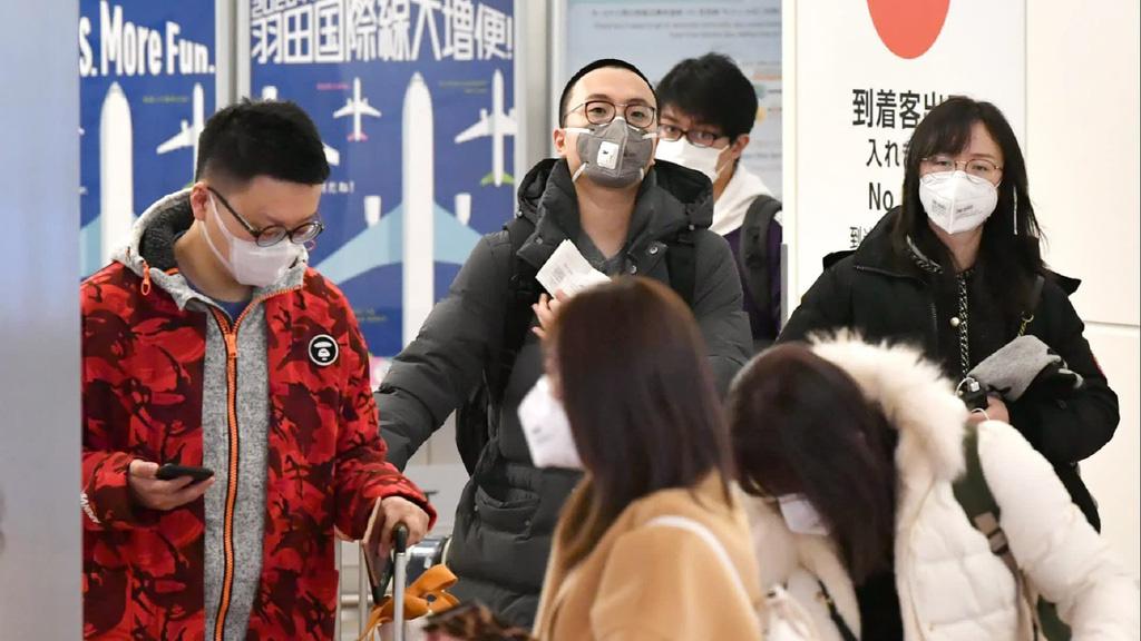 Singapore cấm du khách Trung Quốc nhập cảnh để tránh virus corona  - Ảnh 1.