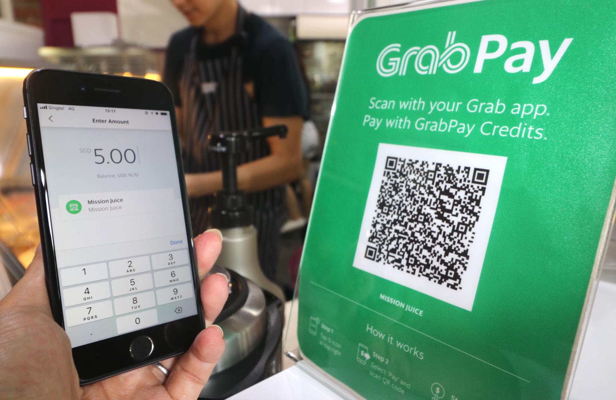 Grab nhận hơn 700 triệu USD từ ngân hàng lớn nhất Nhật Bản, nhắm vào cho vay cá nhân khắp Đông Nam Á - Ảnh 1.