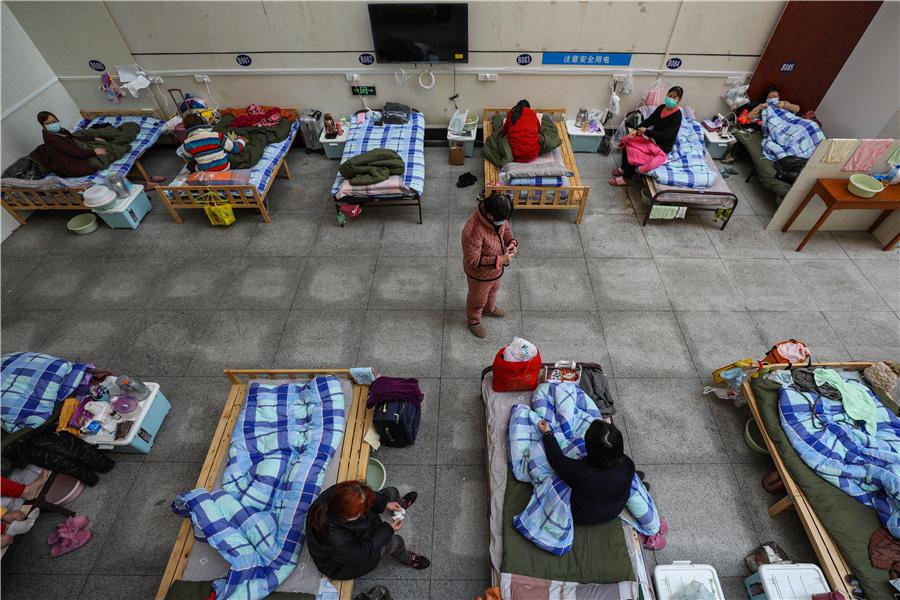 Bên trong bệnh viện dã chiến tại tâm dịch Vũ Hán - Ảnh 8.