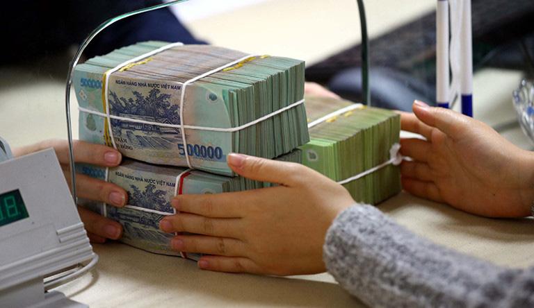 Ngân hàng Nhà nước yêu cầu khoanh nợ, giãn nợ cho người bị ảnh hưởng bởi dịch Covid-19 - Ảnh 1.