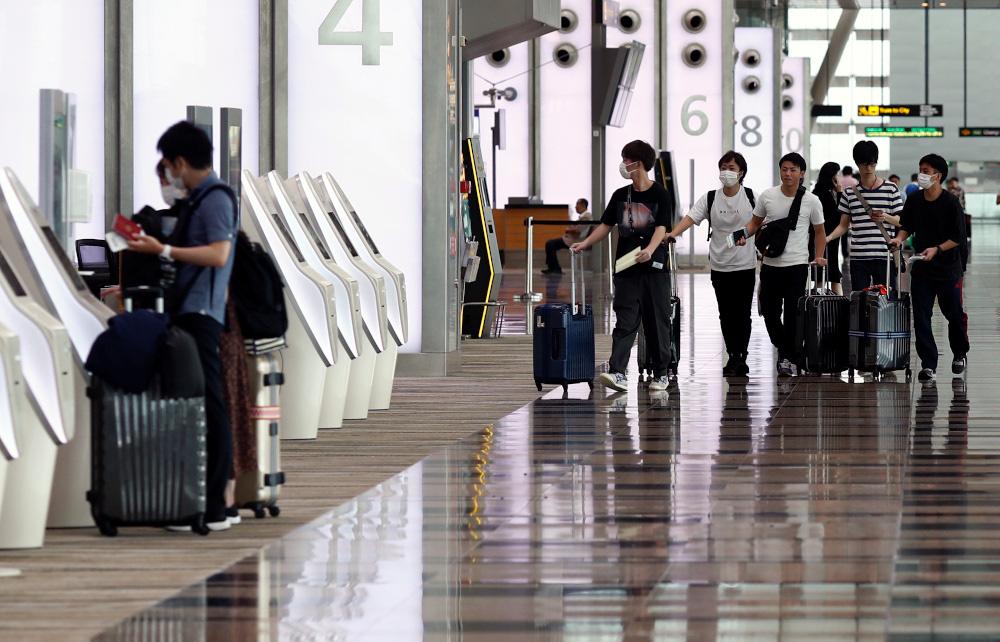 Singapore cấm du khách Italy, Tây Ban Nha, Đức, Pháp nhập cảnh để phòng chống dịch virus corona - Ảnh 1.