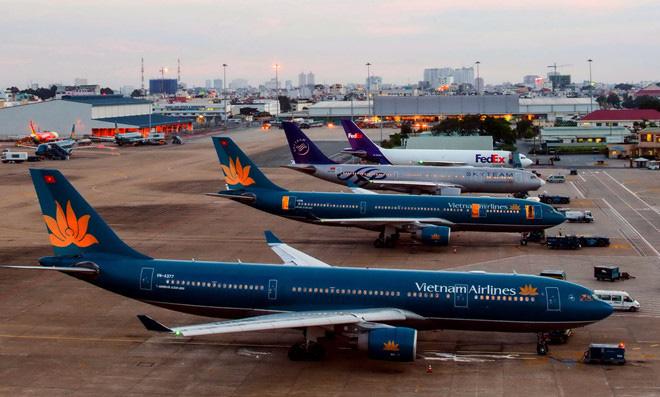 Các hãng hàng không Việt thiệt hại 30.000 tỉ đồng vì dịch Covid-19 - Ảnh 1.