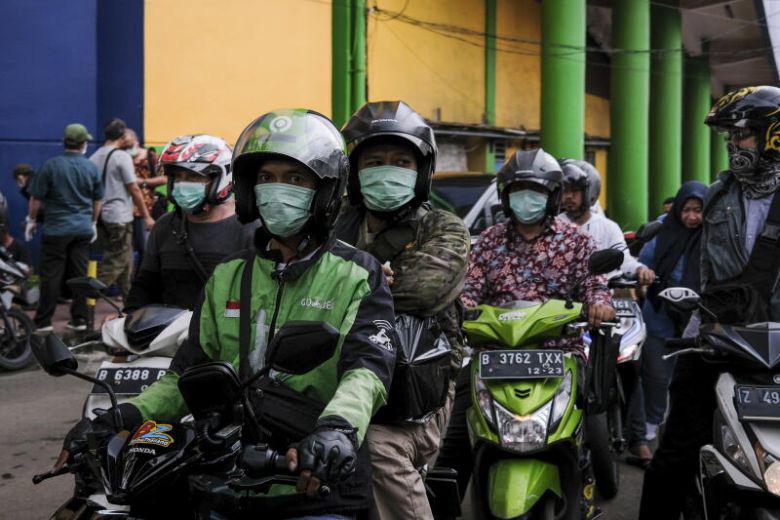 Cập nhật tình hình dịch virus corona ở ASEAN và châu Á ngày 20/3: Malaysia vợt mốc 1.000 ca, Indonesia ước tính hơn 500.000 người đã tiếp xúc với ca nhiễm Covid-19 - Ảnh 3.