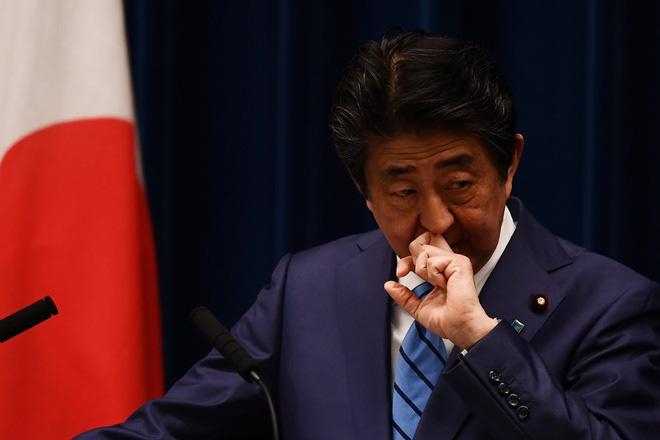 Thủ tướng Nhật lần đầu thừa nhận khả năng hoãn Olympics Tokyo - Ảnh 1.