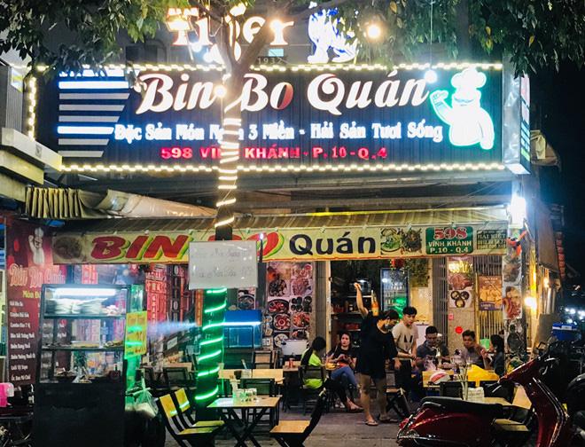 Hơn 2 tiếng sau 'lệnh cấm', phố ẩm thực Vĩnh Khánh vẫn sáng đèn nhộn nhịp - Ảnh 13.