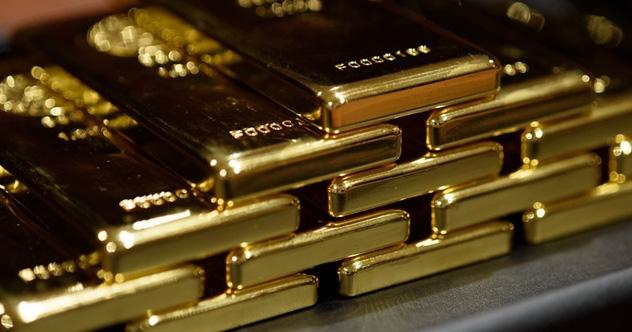 Cuộc săn lùng vàng thỏi 100 ounce trên thế giới và tình cảnh khó khăn của những kẻ bán khống hợp đồng tương lai vàng - Ảnh 1.