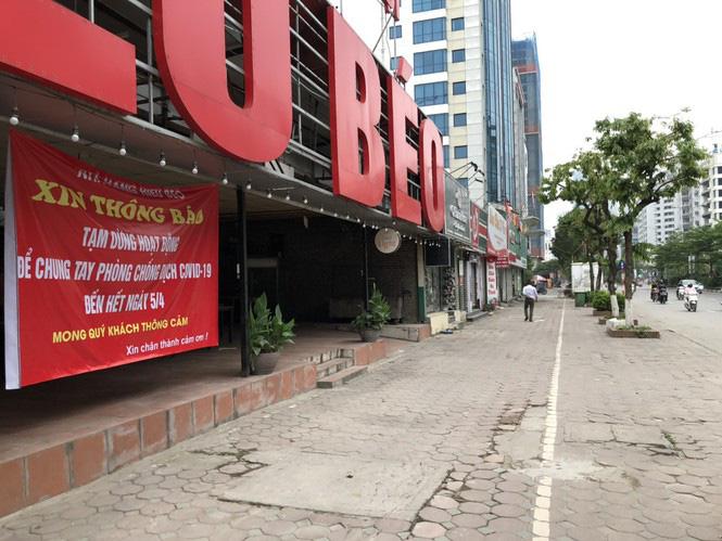 Ngày đầu Hà Nội thực hiện 'lệnh' đóng cửa hàng quán - Ảnh 3.