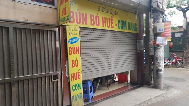 Ngày đầu Hà Nội thực hiện 'lệnh' đóng cửa hàng quán - Ảnh 5.