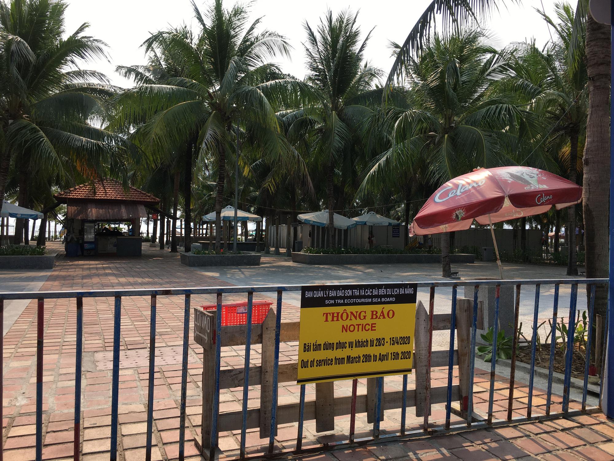 Ven biển Đà Nẵng bị rào chắn hơn 1km, các dịch vụ ngừng hoạt động hàng loạt để phòng dịch Covid-19 - Ảnh 5.