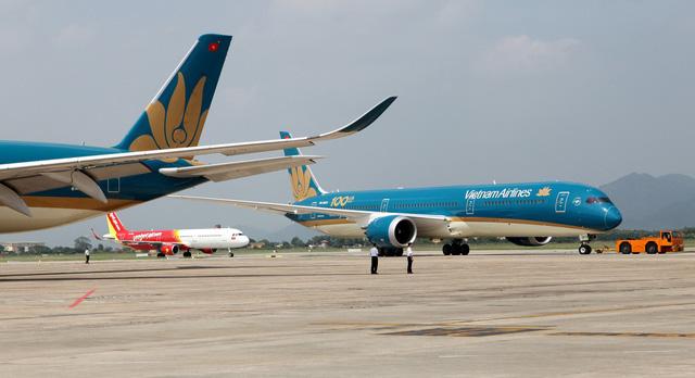 Từ mai (30/3), Vietnam Airlines, Vietjet, Bamboo Airways, Jetstar chỉ còn bay 1 chuyến/ngày chặng Hà Nội - TP HCM - Ảnh 1.
