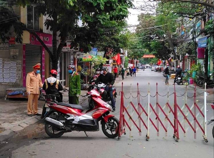 Phong tỏa ba khu dân cư phòng Covid-19 - Ảnh 1.
