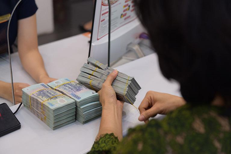 Gói 180.000 tỉ đồng gia hạn thời gian nộp thuế, tiền thuê đất chính thức có hiệu lực - Ảnh 2.