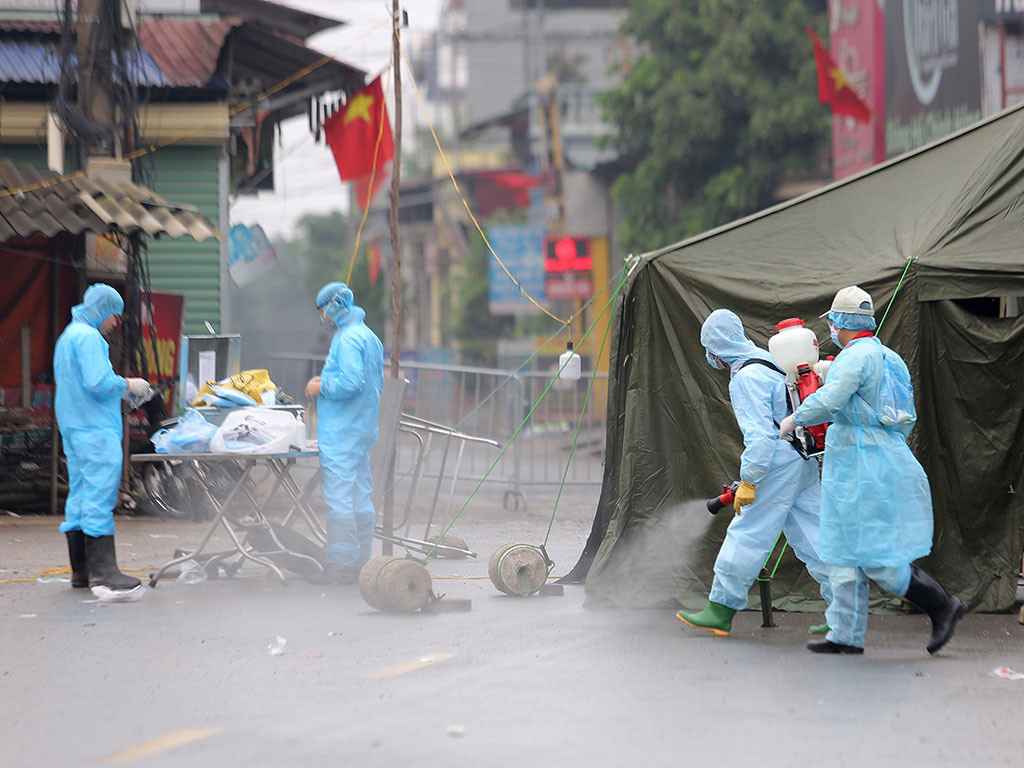 Ngăn chặn dịch lây nhiễm trong cộng đồng - Ảnh 1.